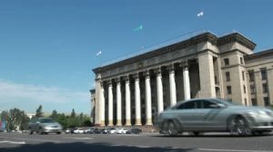stock-footage-almaty-kazakhstan-july-traffic-drives-past-a-large-government-building-in-almaty