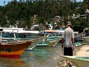stock-footage-motorboats-laying-in-water-out-side-the-city-of-sabang-in-philippines